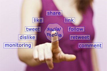 hand touching social media button